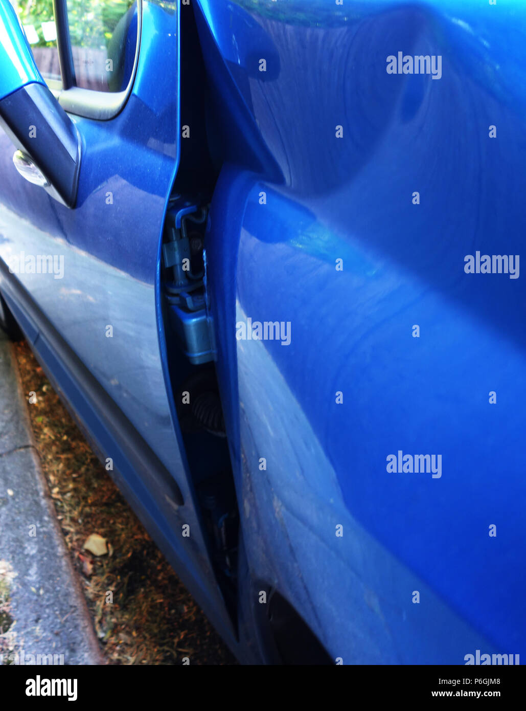 close up photographs of a Peugeot 208 that was dammaged in a car crash leading to front end damage on this car Stock Photo