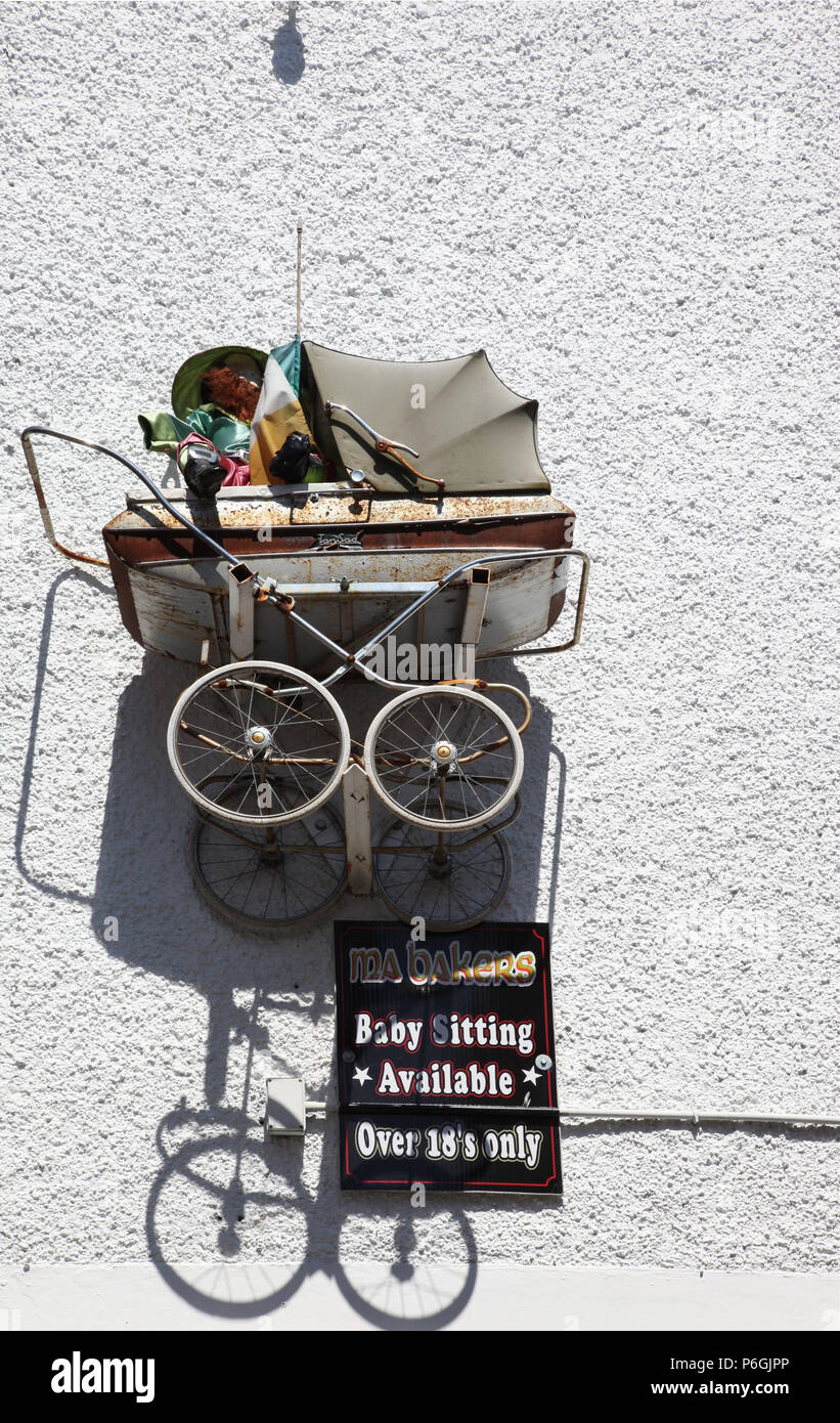 Humourous wall decoration in Carlingford, Co. Louth - Stock Image