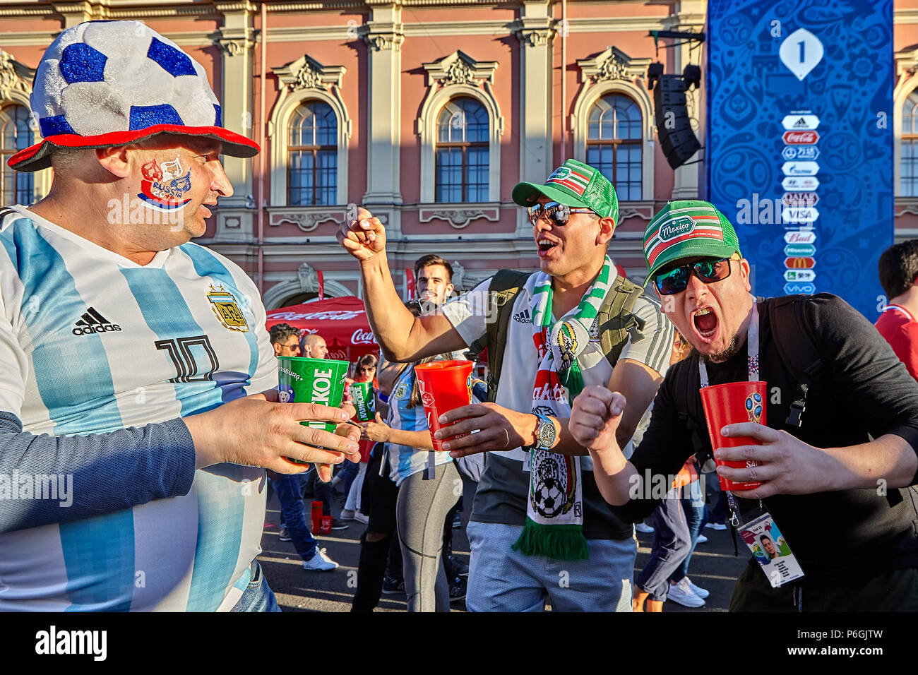 Saint petersburg russia june 25 2018 russian and mexican saint petersburg russia june 25 2018 russian and mexican football fans they greet each other in fanzone during world cup football m4hsunfo