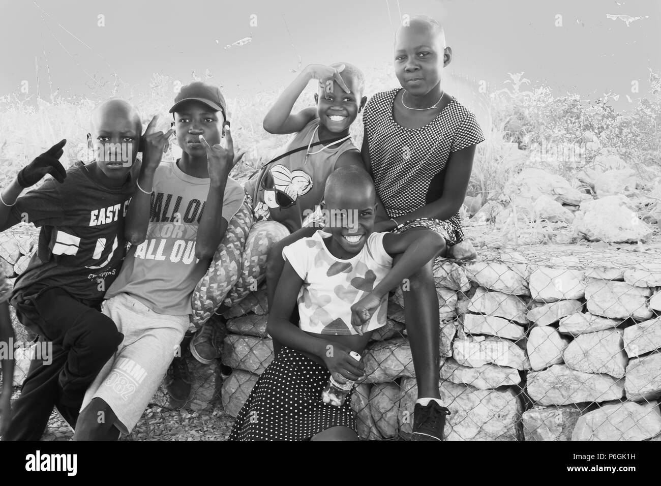 KHOHAXIS, NAMIBIA - MAY 21 2018;  Group of African youth happily responding to being photographed - Stock Image