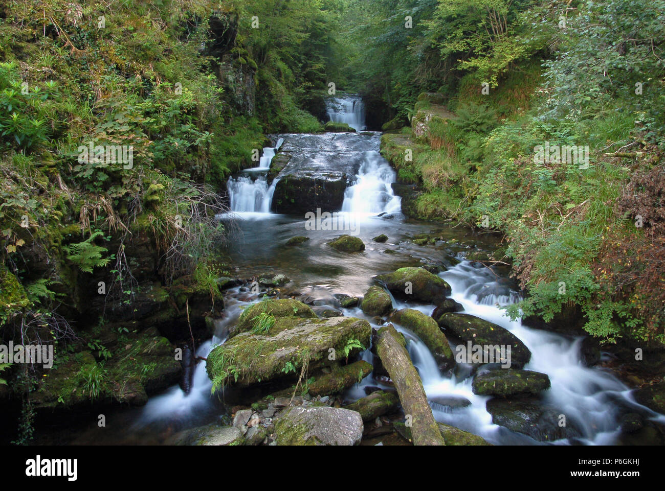 Long Exposure Photograph of a Waterfall near Bucks Mills on the North Devon Coast Area of Outstanding Natural Beauty - Stock Image