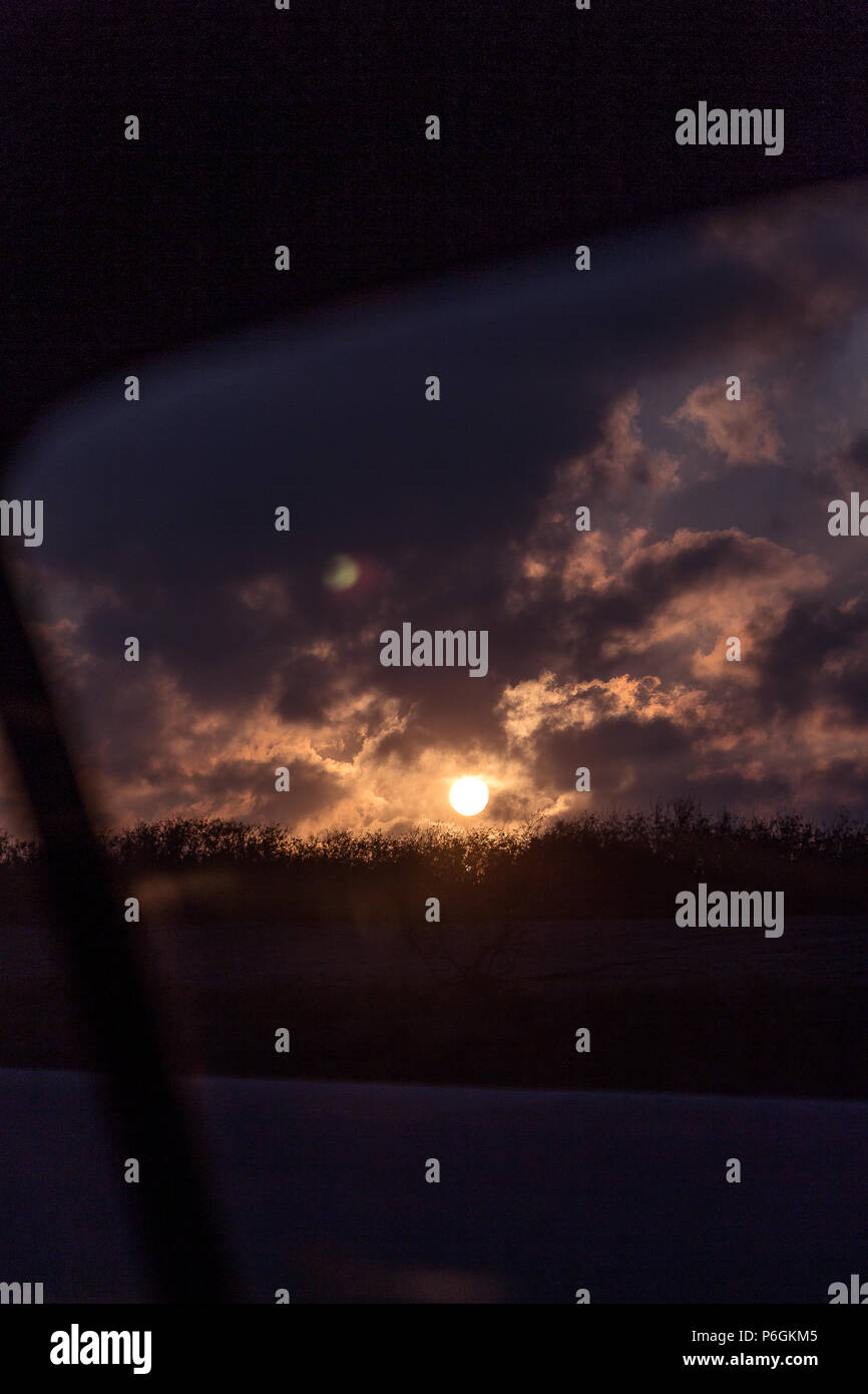 The twilight right as the sun hits the night sky captivates the viewers eye. Stock Photo