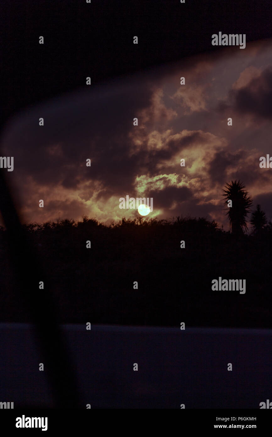 The twilight right as the sun hits the night sky captivates the viewers eye. - Stock Image