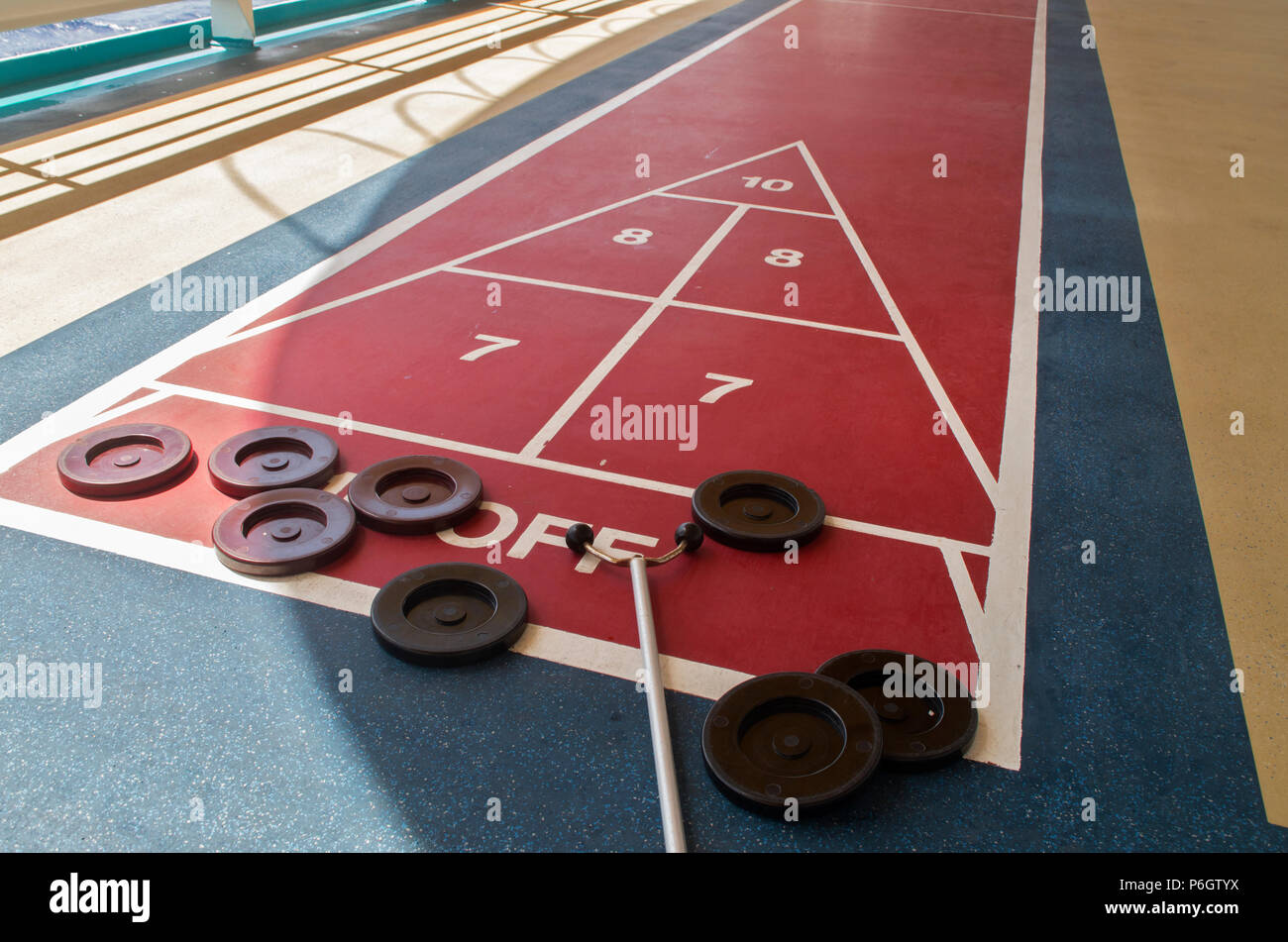 The shuffleboard game is ready to play on a cruise ship in the Caribean Sea - Stock Image