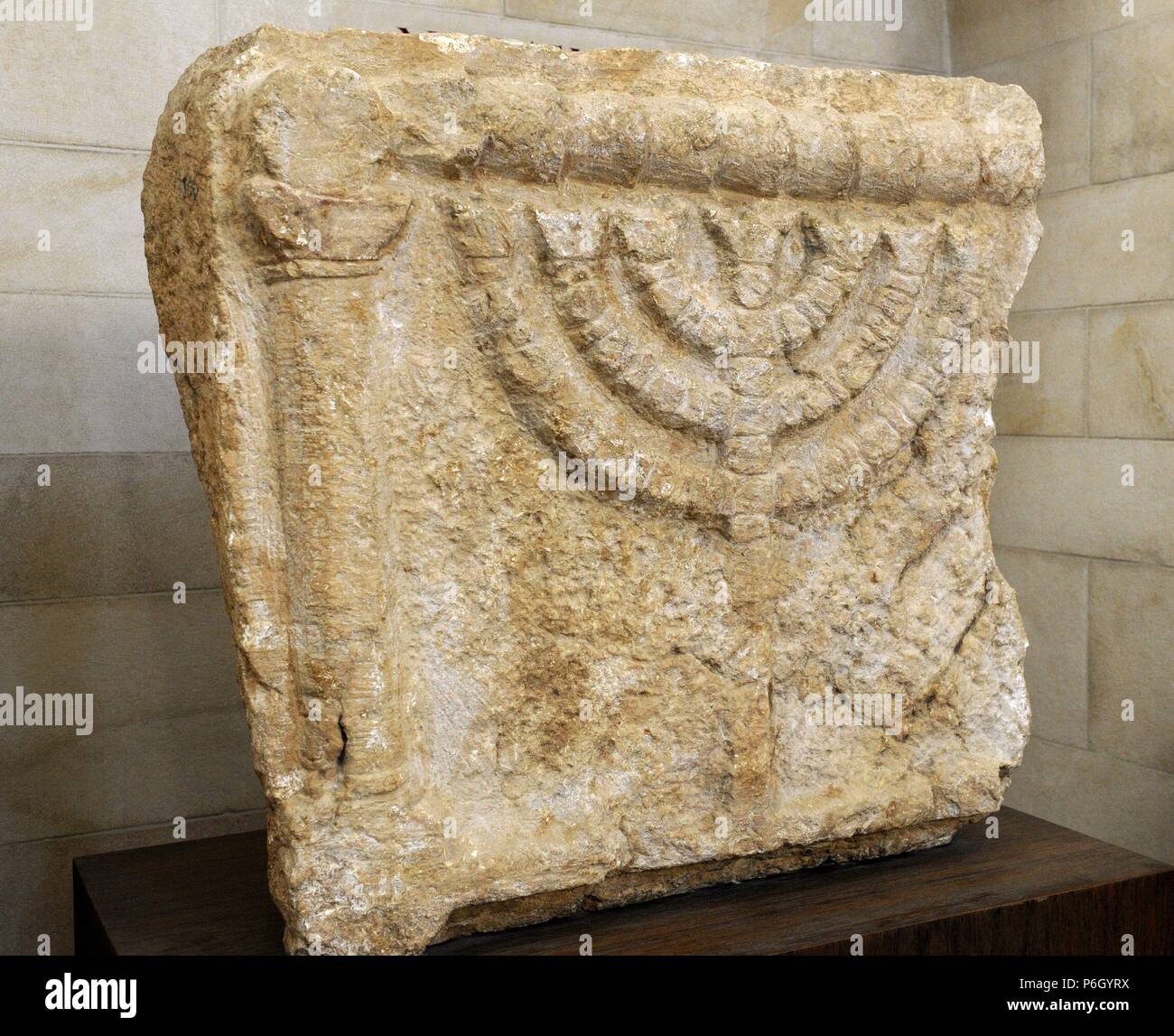 Stone lintels decorated with the Seven-Branched Menorah synagogue at Eshtemoa. Southern Hebron hill region. 3rd-4th century CE. Rockefeller Archaeological Museum. Jerusalem. Israel. - Stock Image
