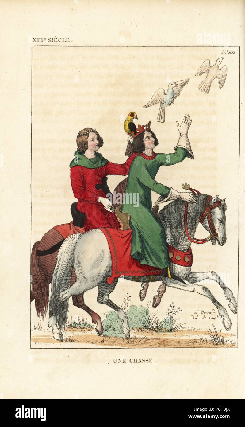 French noble couple hunting with falcons, 13th century. He wears a crown, long green robe, gauntlets and long cracows or poulaines. She wears her hair tied with pearls, green hood and red robe, and holds a falcon on her gauntlet. Handcoloured copperplate drawn and engraved by Leopold Massard from 'French Costumes from King Clovis to Our Days,' Massard, Mifliez, Paris, 1834. - Stock Image