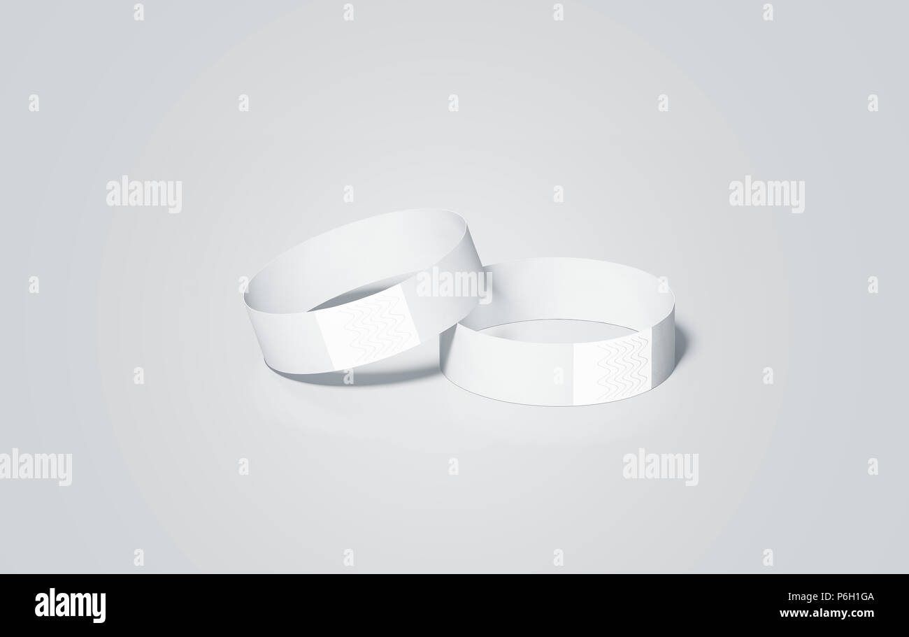 Blank white paper wristbands mock ups, 3d rendering. Empty event wrist bands design mockup. Cheap hand bracelets template, isolated. Clear bangle wristlet set with sticker. Concert armlet - Stock Image
