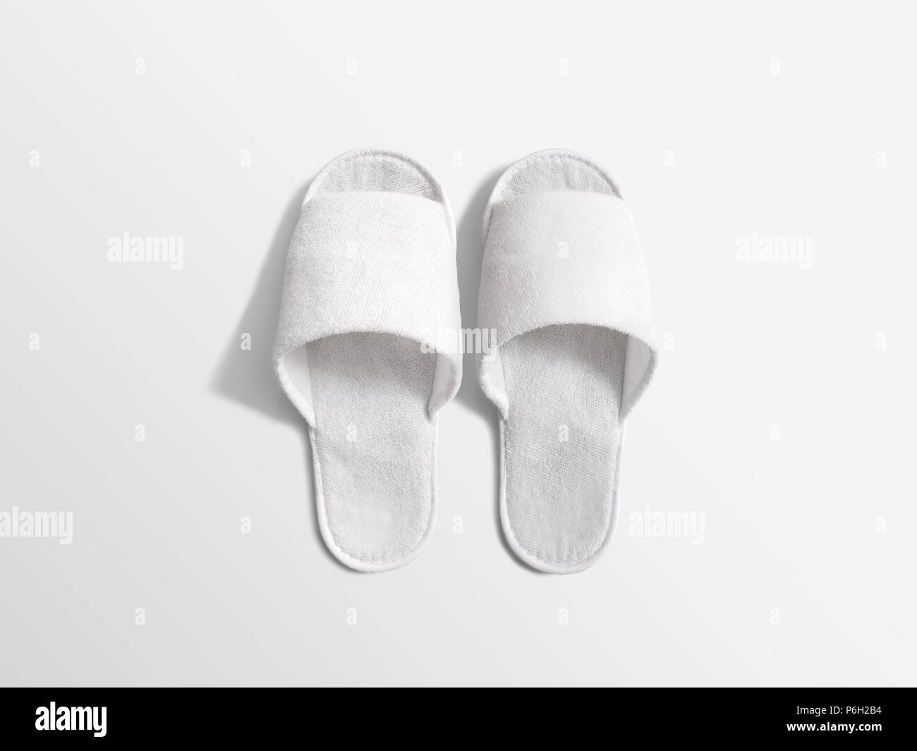 Pair of blank white home slippers, design mockup  House