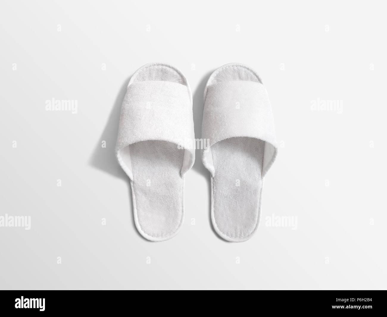 Pair of blank white home slippers, design mockup  House plain flops