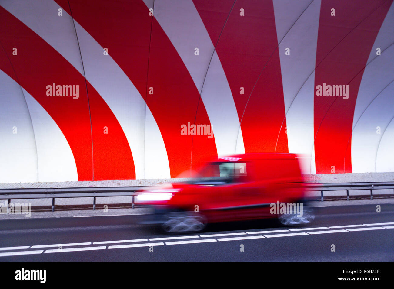 Red Car Game >> A Red Car Driving Fast In A Tunnel With Red Dynamic Stripes On The