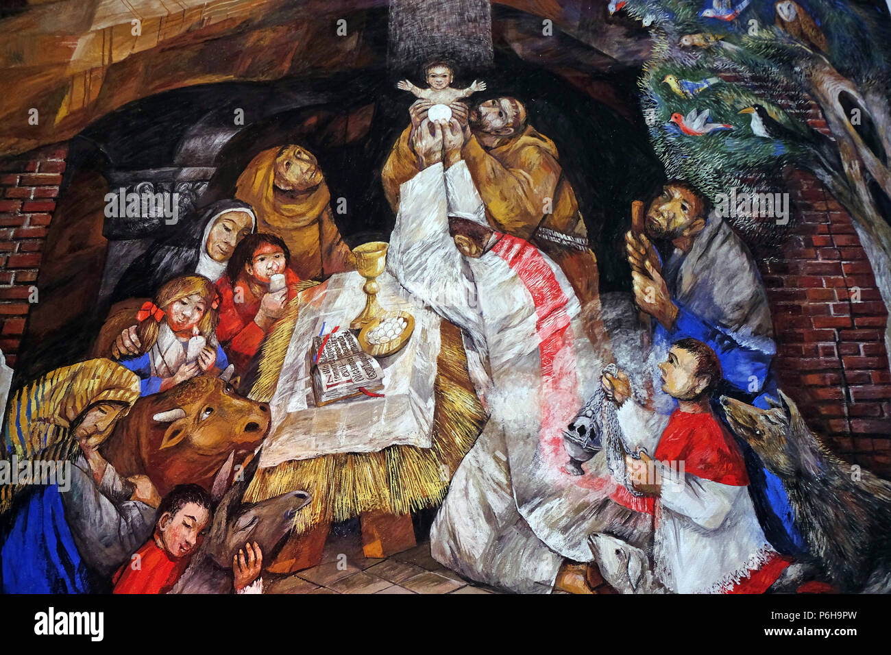 St. Francis celebrates Christmas in Greccio fresco by Sieger Koeder in the Chapel of St. Francis in Ellwangen, Germany Stock Photo