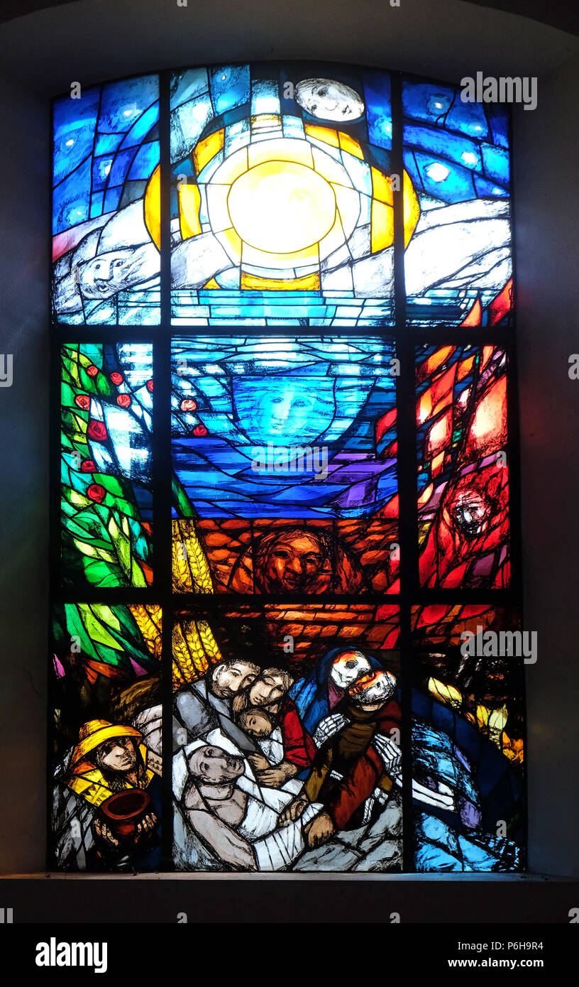 Stigmatization of Saint Francis of Assisi, stained glass window by Sieger Koeder in the Chapel of St. Francis in Ellwangen, Germany Stock Photo