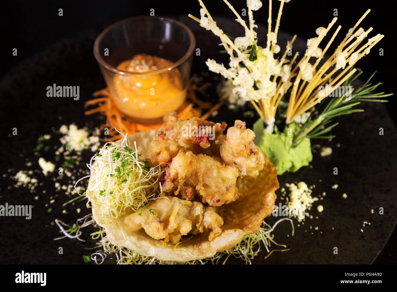 Lobster tempura with Sriracha mayo. The deep fried dish has Asian influences. - Stock Image