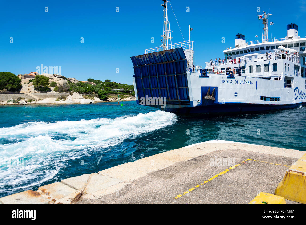 Sardinia, Italy, 06-09-2018: Summer landscape with the ferry boat colored in white and blue travelling from palau, sardinia to La Maddalena Archipel. Stock Photo