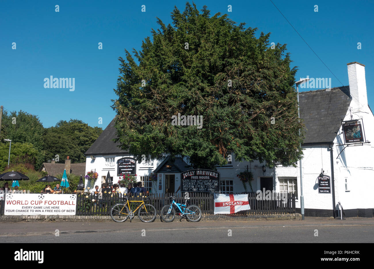 People enjoying warm day at Jolly Brewers pub Milton Cambridge - Stock Image