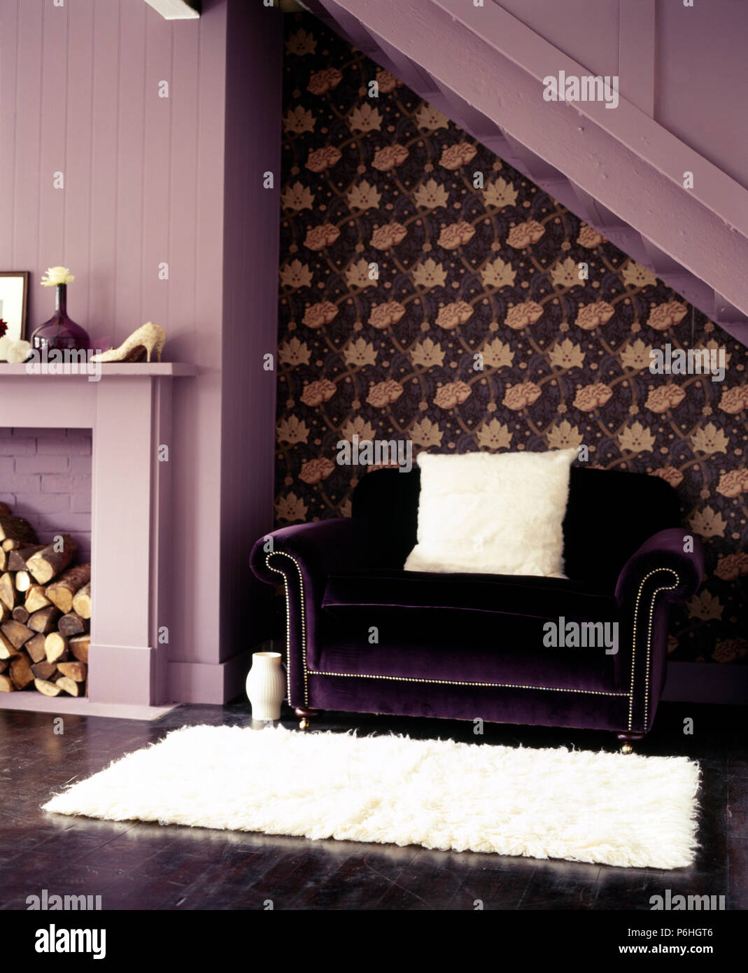Purple Velvet Sofa And A White Faux Fur Rug In A Mauve