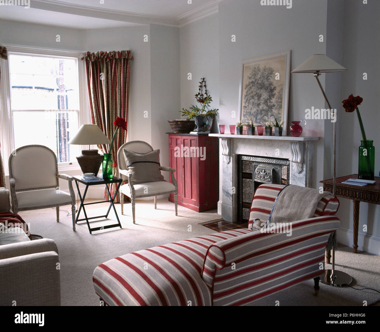 Red Striped Chaise Longue And In Town House Living Room With A Marble Fireplace