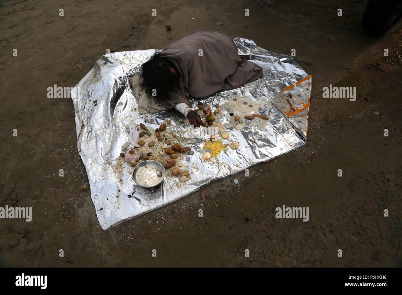 Beggar disabled handicapped burnt Maha Kumbh mela 2013 in Allahabad , India - Stock Image