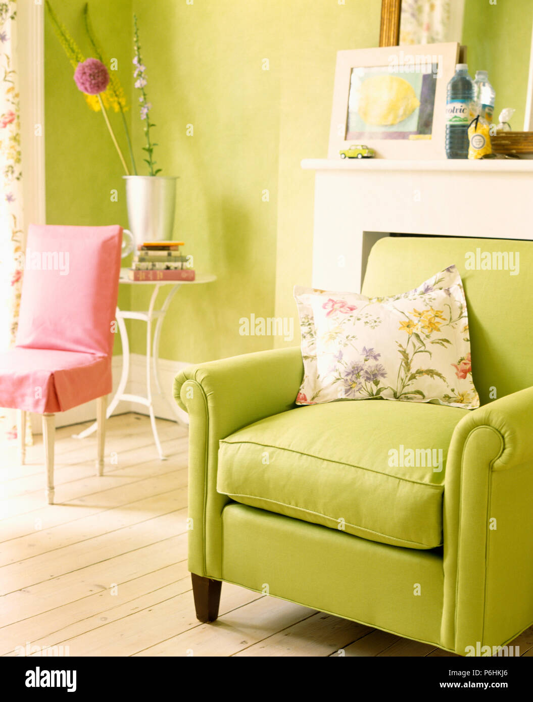 Floral cushion on lime-green armchair in pale lime-green ...