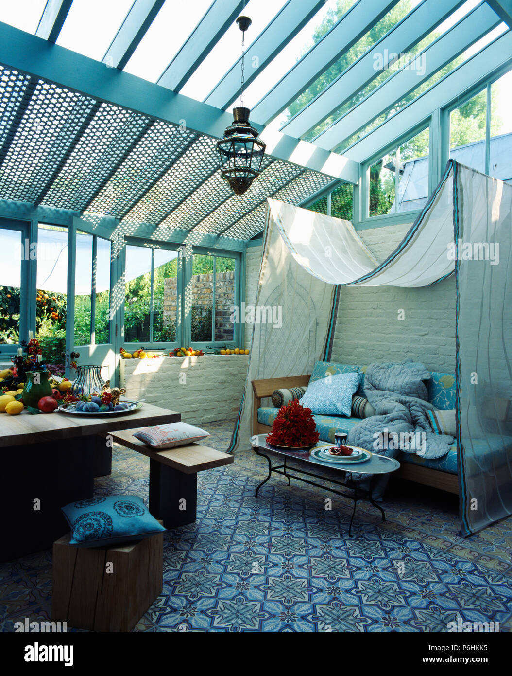 Patterned white linen canopy above sofa in living and dining room conservatory with patterned blue carpet & Patterned white linen canopy above sofa in living and dining room ...