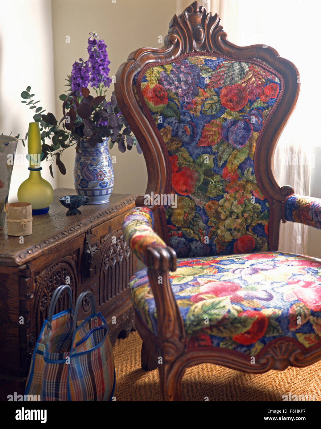 Incroyable Close Up Of Bright Floral Upholstered Victorian Armchair And Carved Wooden  Chest