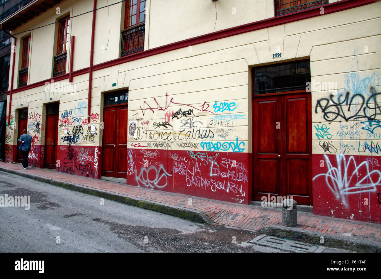 Graffiti strewn walls in Bogota, Colombia, without the art - Stock Image