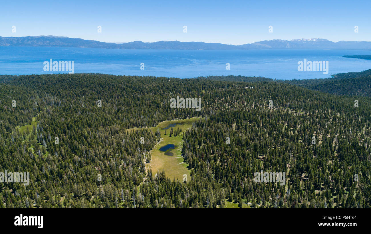 Paige Meadows, a popular hike and mountain bike trail in North Lake Tahoe along the Tahoe Rim Trail as seen from the air. - Stock Image