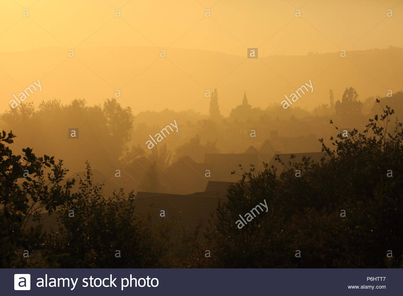 The Neighbouring Town Of Mossley Is Engulfed In Dense Smoke From The Fires Over Saddleworth Moor, Saddleworth, Oldham, Greater Manchester Summer 2018 - Stock Image