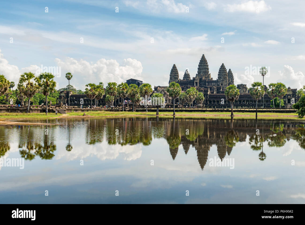 Angkor Wat, Cambodia - November 17, 2017: Tourists are visiting Angkor Wat main temple with reflection in the water. It is the largest religious compl - Stock Image