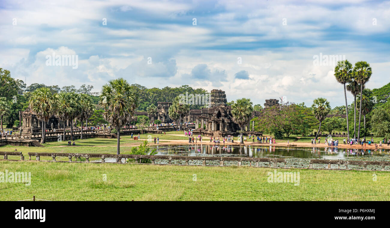 Angkor Wat, Cambodia - November 17, 2017: Tourists at North reflecting pond just in front of North Library in Angkor Wat. It is the largest religious  - Stock Image