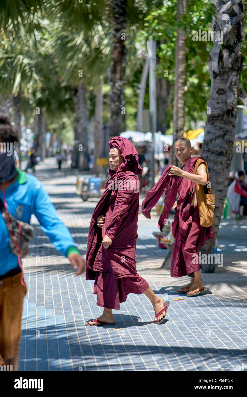 Buddhist monks from Myanmar (Burma) visiting Thailand as tourists. Thai street scene - Stock Image