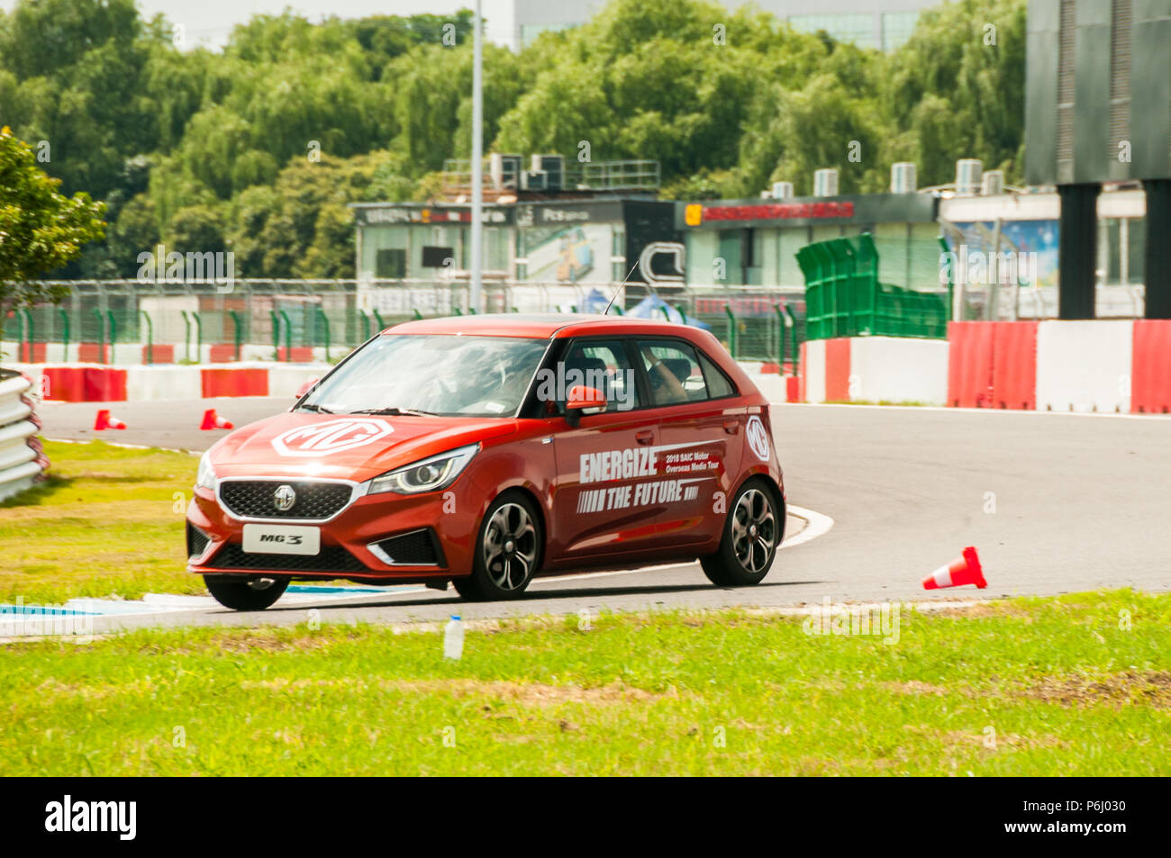Late life update MG 3 from SAIC being driven on the Tianma Race Circuit in Shanghai at an overseas media event. Stock Photo
