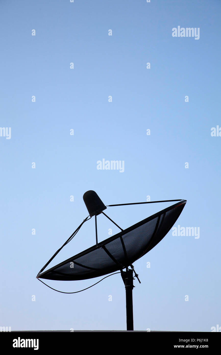 satellite tv aerial on Dubai rooftop - Stock Image