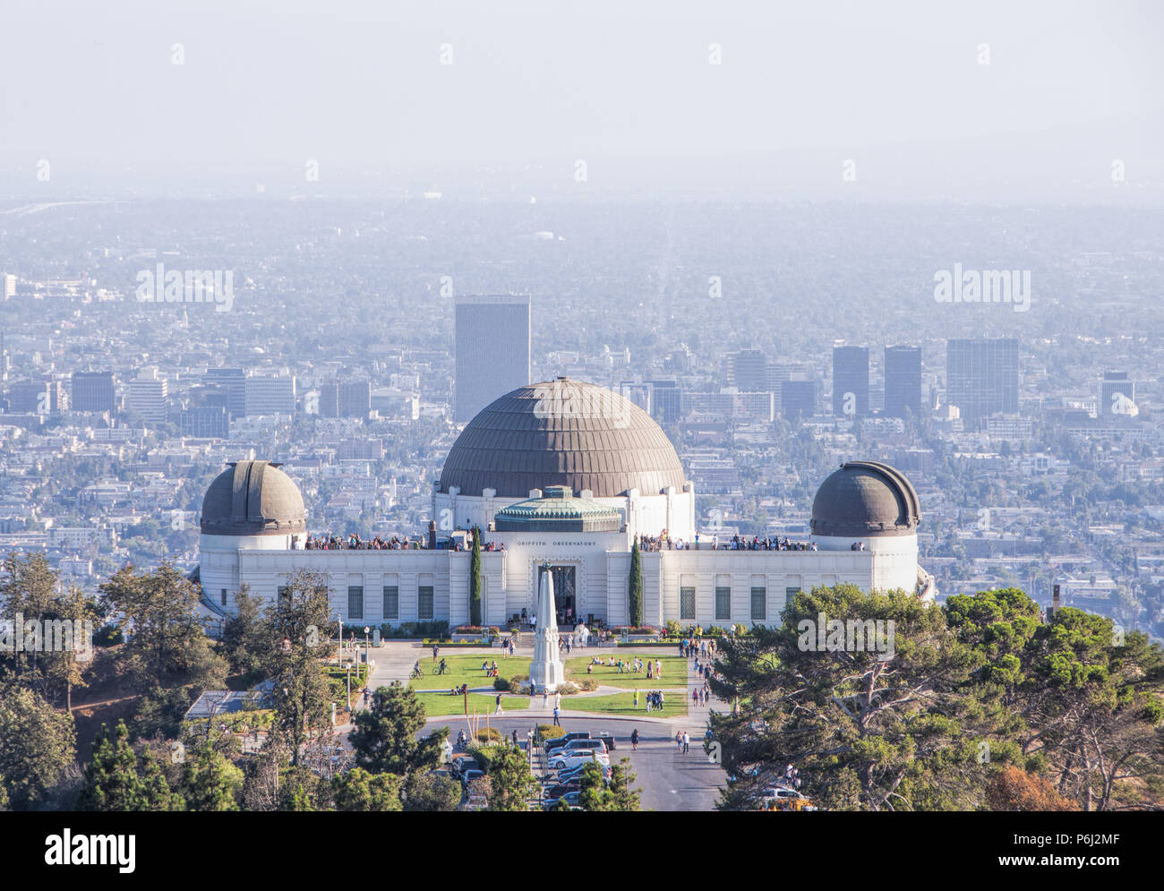 4 September 2016 - Los Angeles, USA. Famous Griffith Observatory museum building on the Hollywood Hills. Many tourists visiting planetarium with sceni - Stock Image