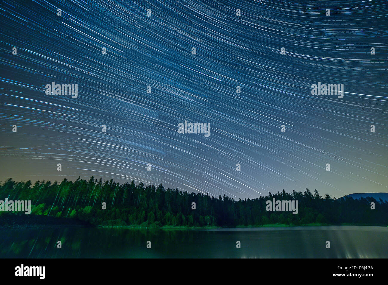 Startrails on lake Lokve in Croatia Stock Photo