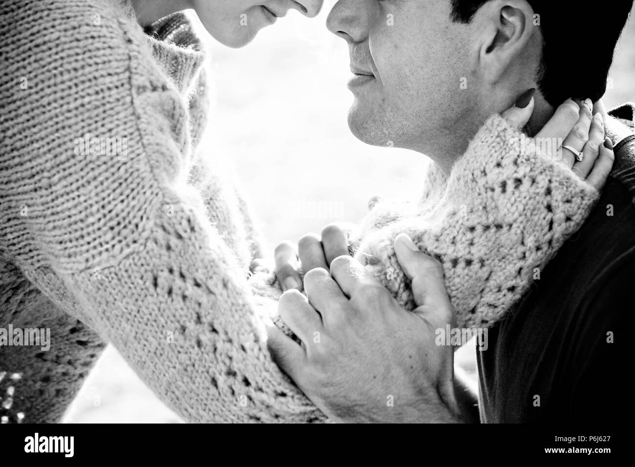 couple of caucasian model man and woman hug and love with passion taking themselves and stay close lips to lips. little smile and face together in a t - Stock Image