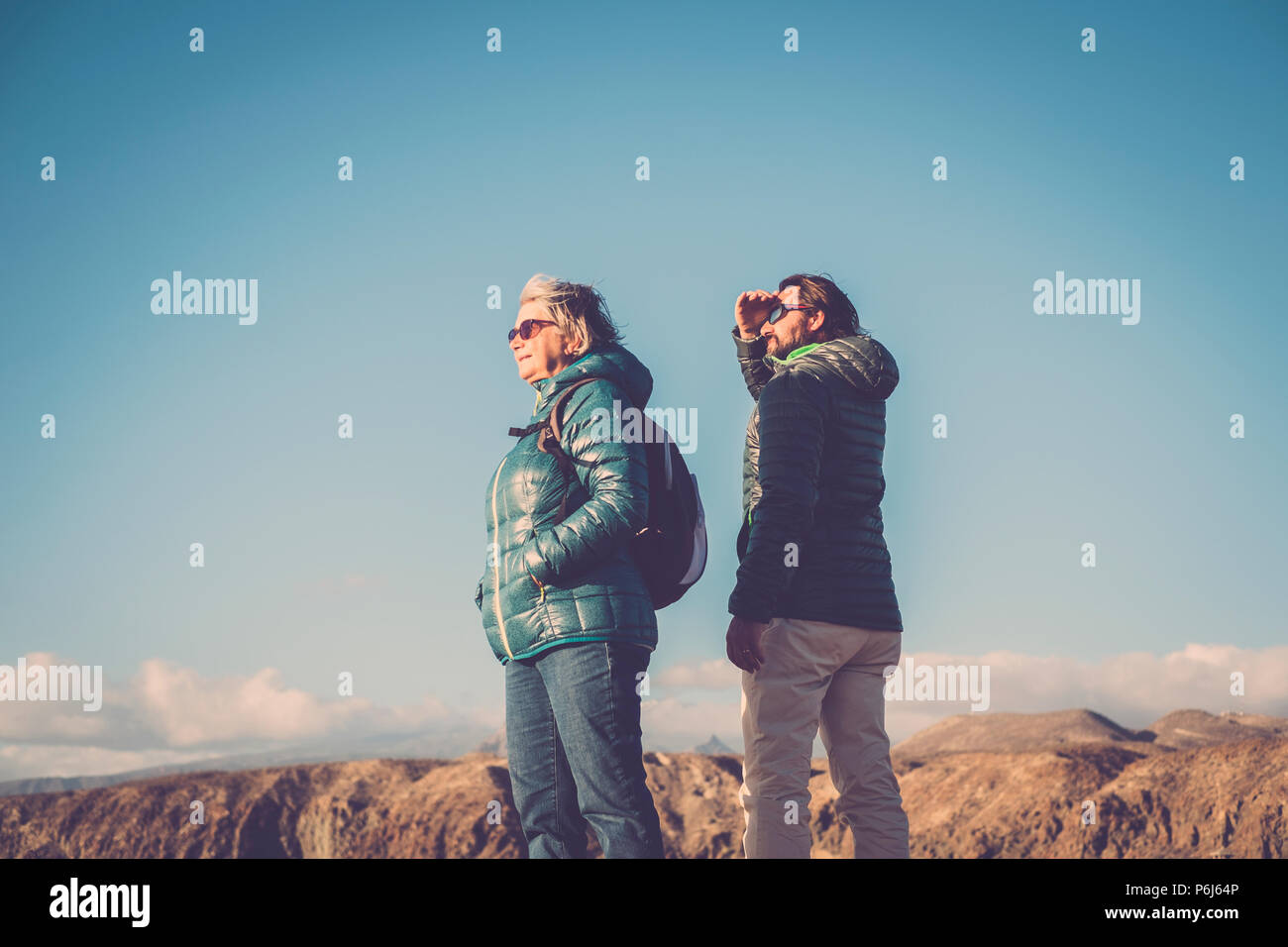 couple different ages like mother and son walk together in trekking activity on a top of a mountain. hiking leisure active people outdoor in the natur - Stock Image
