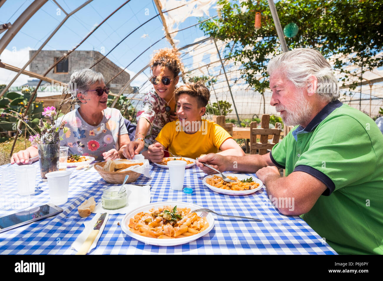 nice leisure activity outdoor in natural bio restaurant for nice beautiful caucasian family with all generations from young to old. mother, son, grand - Stock Image