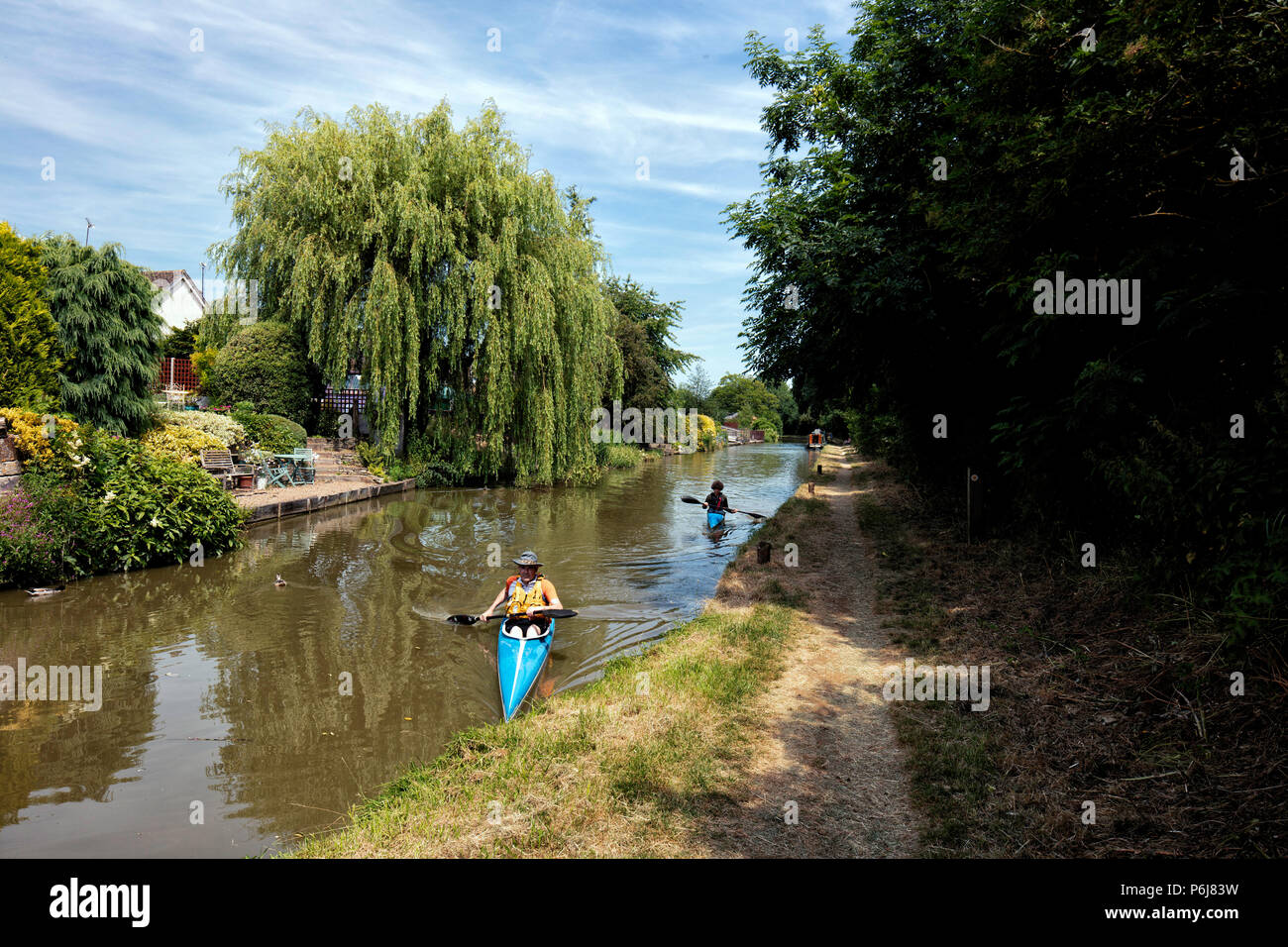 Two kayaks on the Oxford Canal on a sunny, summer day at Cropredy near Banbury - Stock Image