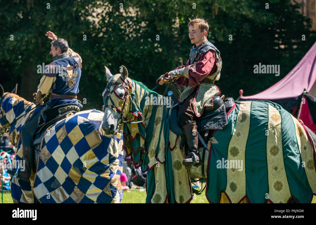 Jousting and Medieval Fair at Linlithgow Palace, Linlithgow, Scotland, United Kingdom, 30th June 2018. Historic Environment Scotland kick off their summer entertainment programme with a fabulous display of Medieval jousting in the grounds of the historic castle. The family fun day includes living history camps, medieval games, crafts, archery, and falconry. The jousting is performed by Les Amis D'Onno equine stunt team based in the Borders. Knights Sir Archibald Douglas and Sir Antoine Le Grand Chevalier D'Outremer, played by Antoine Ruault, on their horses - Stock Image
