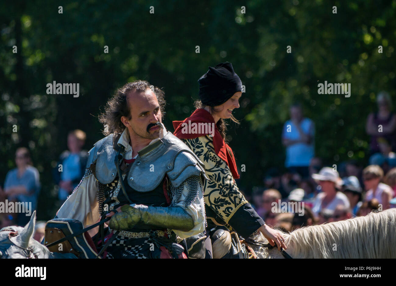 Jousting and Medieval Fair at Linlithgow Palace, Linlithgow, Scotland, United Kingdom, 30th June 2018. Historic Environment Scotland kick off their summer entertainment programme with a fabulous display of Medieval jousting in the grounds of the historic castle. The family fun day includes living history camps, medieval games, crafts, archery, and falconry. The jousting is performed by Les Amis D'Onno equine stunt team based in the Borders. Knight Sir Checkmate Fitzpercy, played by Jacob Martin - Stock Image