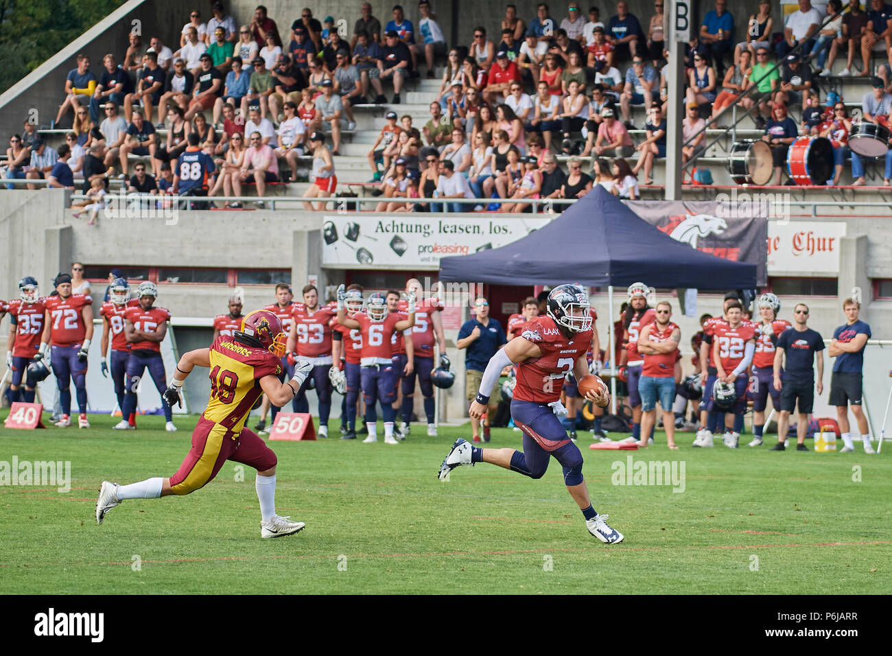 Chur, Switzerland. 30th June 2018. Clark Evans runs for a Touch Down during the American Football Swiss Bowl Play-of Game Calanda Broncos vs. Winterthur Warriors. Credit: Rolf Simeon/Alamy Live News - Stock Image