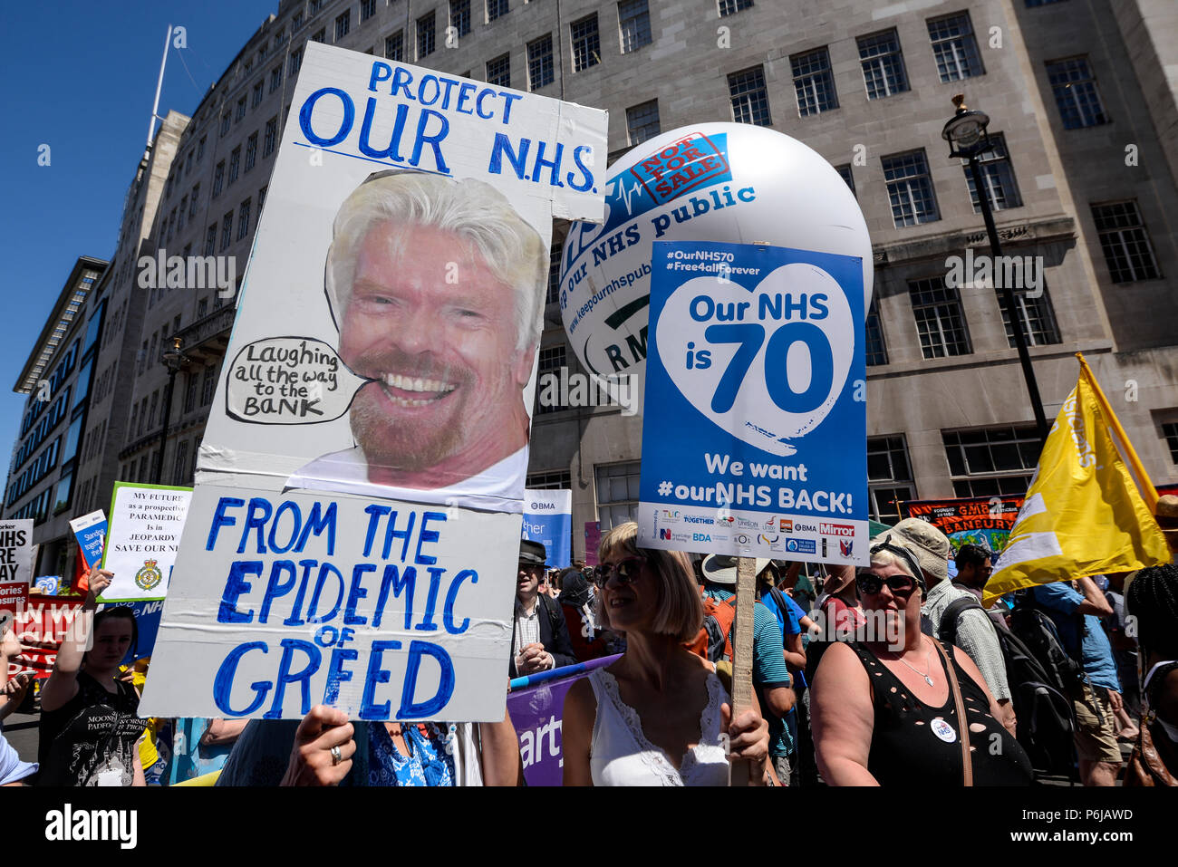 70th anniversary of the National Health Service, also being used to demonstrate against austerity, funding cuts and moves to sell departments to the private sector - Stock Image