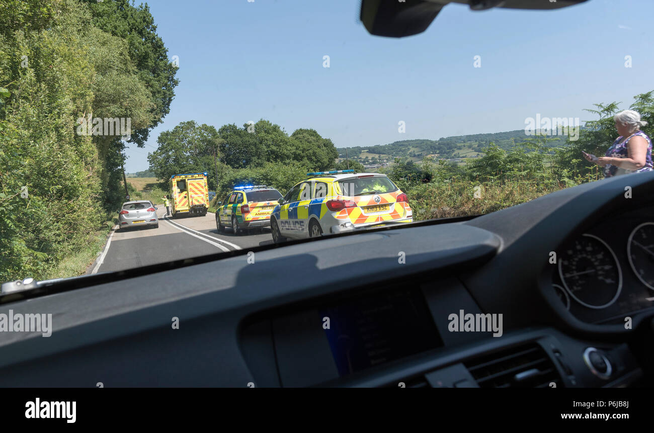 Emergency service vehicles at the scene of an accident on the 303 holiday route in Devon causing long traffic tailbacks - Stock Image