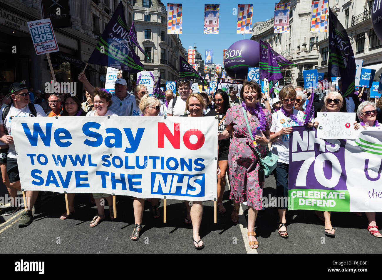 London, UK. 30th June, 2018. TUC General Secretary Frances O'Grady (CR) joined thousands of demonstrators taking part in a march followed by a rally outside Downing Street in central London to celebrate the 70th anniversary of the National Health Service. Protesters call for an end to austerity policies which lead to underfunding and staff shortages in the NHS, and demand that it remains publicly owned and accessible to everyone. Credit: Wiktor Szymanowicz/Alamy Live News - Stock Image