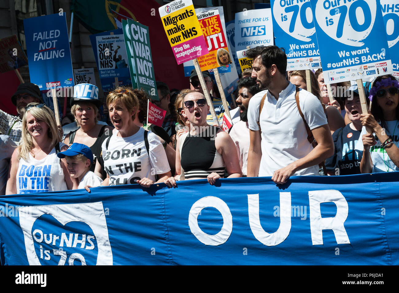London, UK. 30th June, 2018. Actor Ralf Little (CR) joined thousands of demonstrators taking part in a march followed by a rally outside Downing Street in central London to celebrate the 70th anniversary of the National Health Service. Protesters call for an end to austerity policies which lead to underfunding and staff shortages in the NHS, and demand that it remains publicly owned and accessible to everyone. Credit: Wiktor Szymanowicz/Alamy Live News - Stock Image