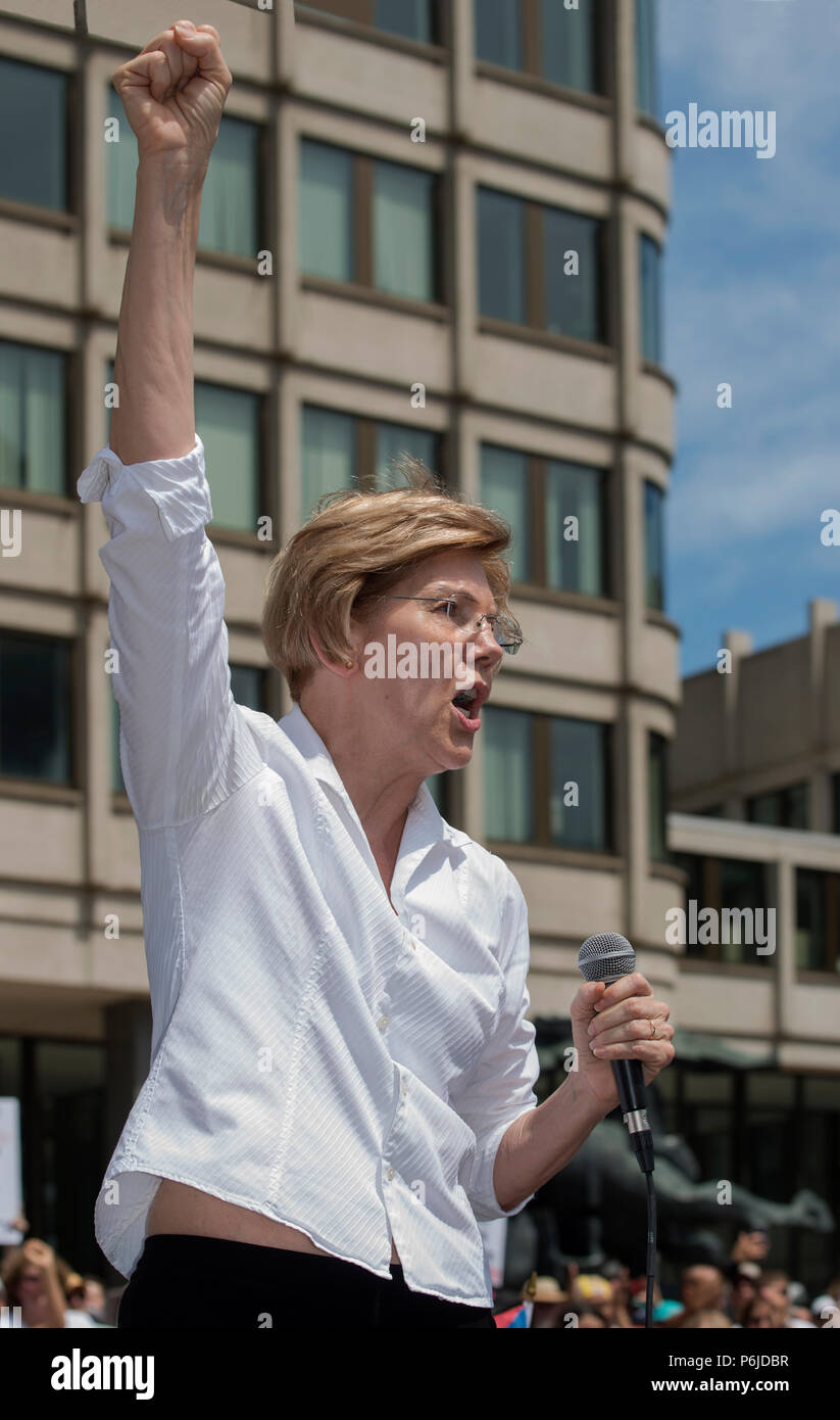 Boston, Massachusetts, USA. 30th June, 2018.  U.S. Senator Elizabeth Warren (Democrat Massachusetts) raises her fist as she spoke to thousands from the back of a truck at Boston City Hall during the Rally against Family Separation in Boston, MA. Demonstrations against U.S. President Donald Trump's immigration policy of detaining central American and Mexican immigrants and the separation of immigrant families.  Large rallies against President Trump's policy of separating migrant families took place in more than 750 U.S. cities on June 30th of 2018. Chuck Nacke / Alamy Live News Stock Photo