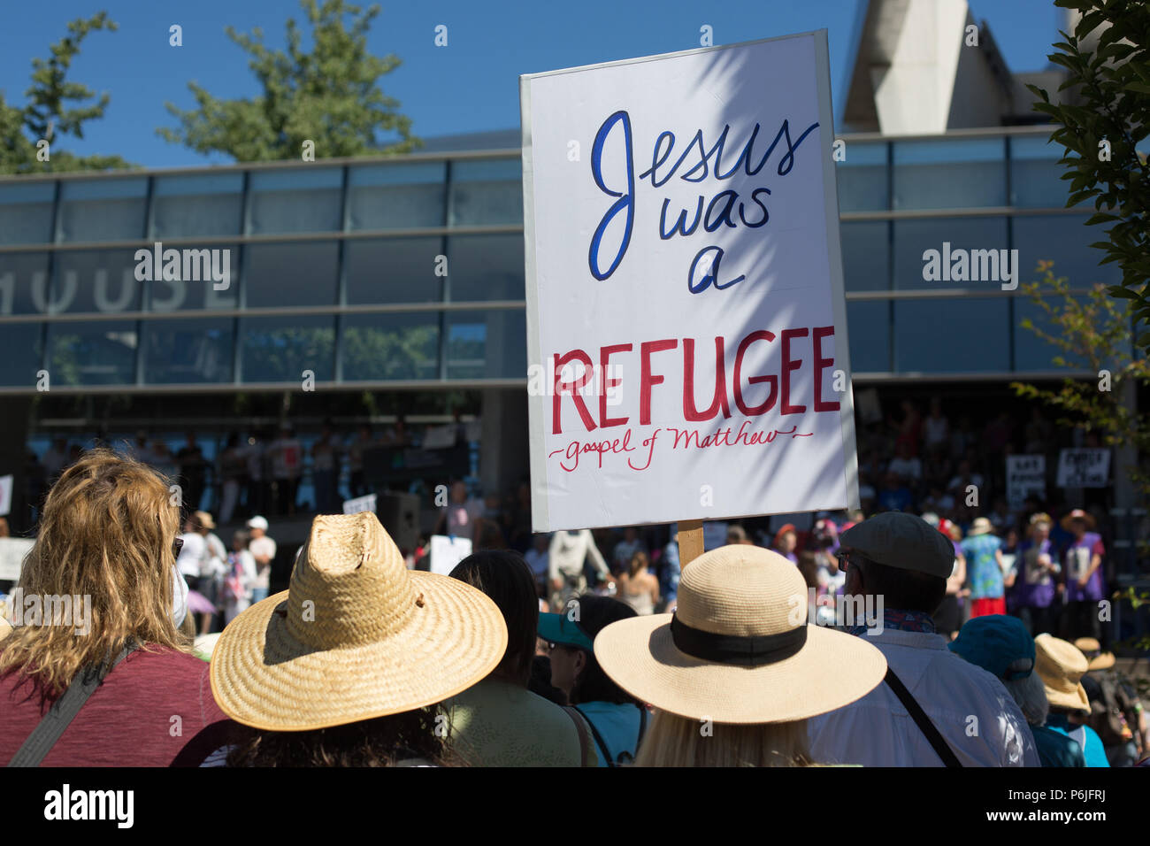 Eugene, Oregon, USA. 30th June, 2018. Citizens rally to protest the separation of immigrant children from their parents when crossing the border into the United States. Copyright: Gina Kelly/Alamy Live News - Stock Image
