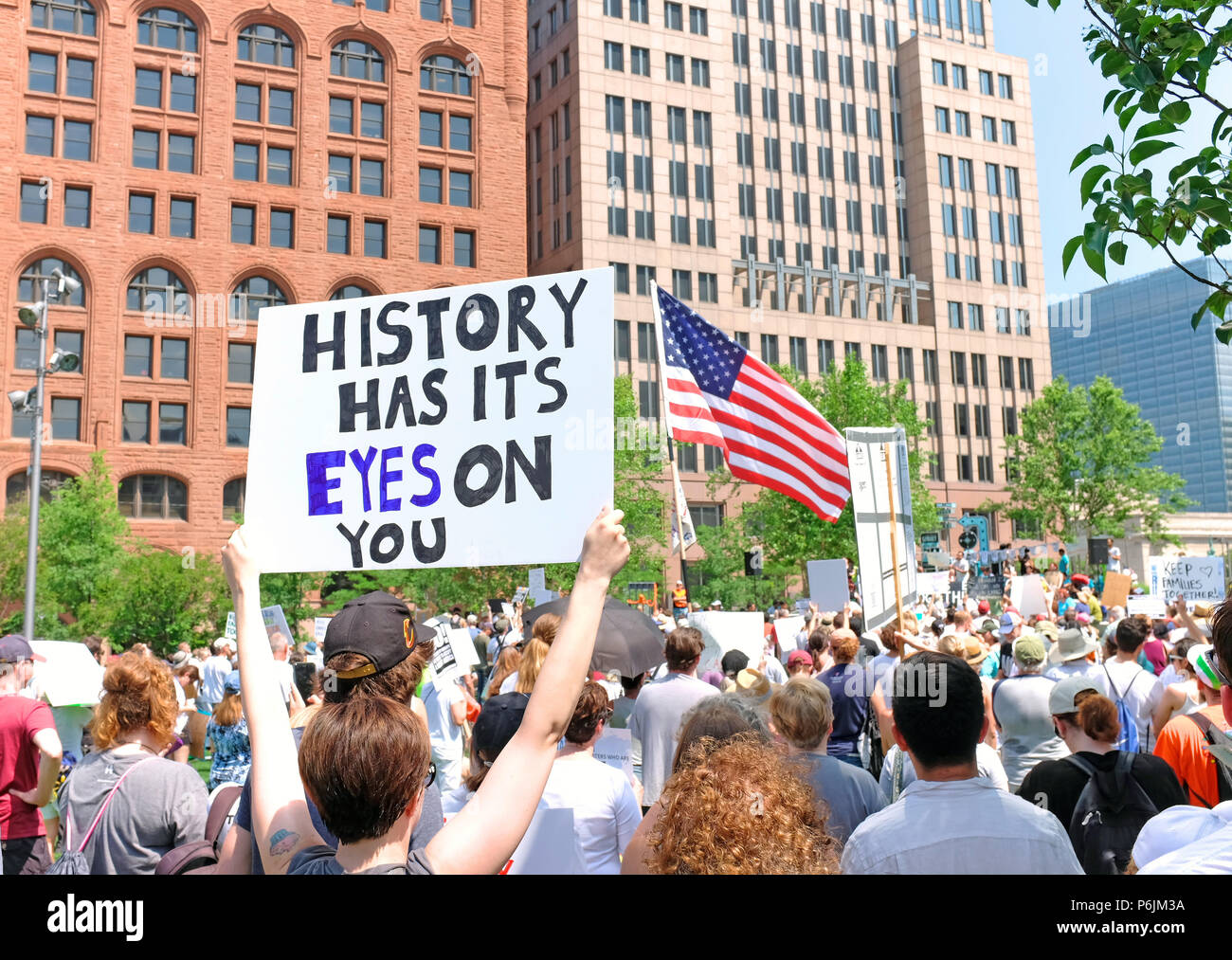 Cleveland, United States.  30th June, 2018.Protestors take to Public Square in downtown Cleveland, Ohio in opposition to the Trump administration policies separating children from parents at the borders. Credit: Mark Kanning/Alamy Live News - Stock Image