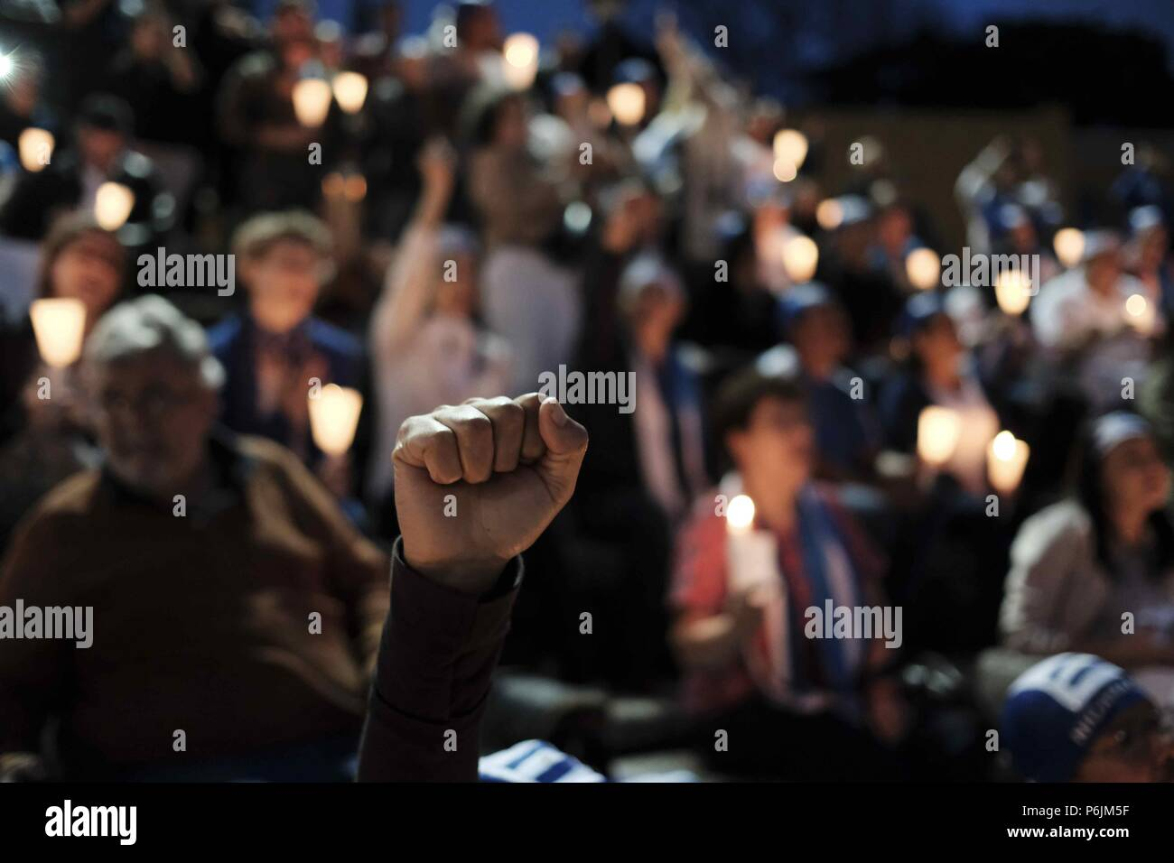 People participate in a vigil, organized by the Nicaraguan community, at Democracy Square in San Jose, Costa Rica, 30 June 2018. A group of Nicaraguans living in Costa Rica gathered to protest against the deaths of more than 280 people in the recent civil unrest in Nicaragua. EFE/Jeffrey Arguedas - Stock Image